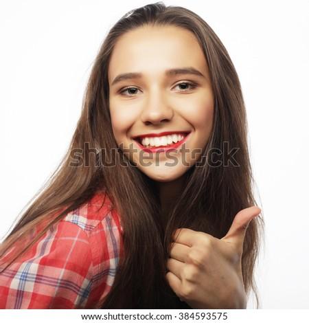 Happy woman giving thumb up - stock photo