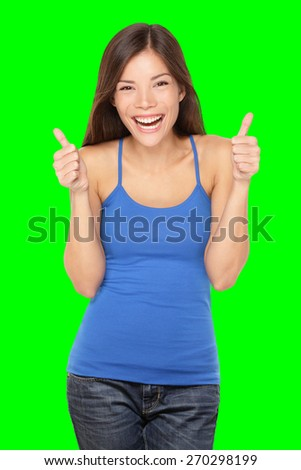Happy woman giving thumbs up success hand sign smiling joyful and happy. Pretty young multiracial Asian / Caucasian female model in tank top. Isolated on green screen chroma key background. - stock photo