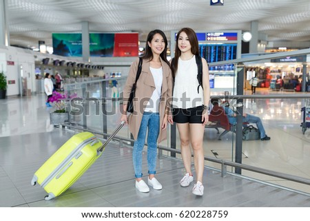 Happy woman go travel together in Hong Kong airport