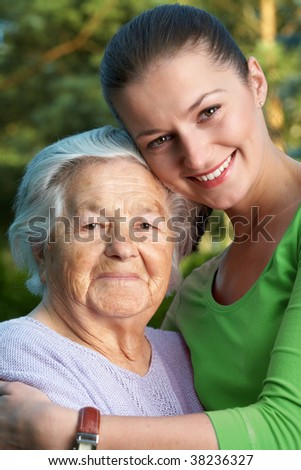 Happy woman, grandmother and her granddaughter - stock photo