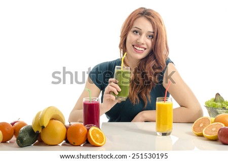 Happy woman having a table full of organic food,juices and smoothie. Cheerful young woman eating healthy salad and fruits. Isolated on white