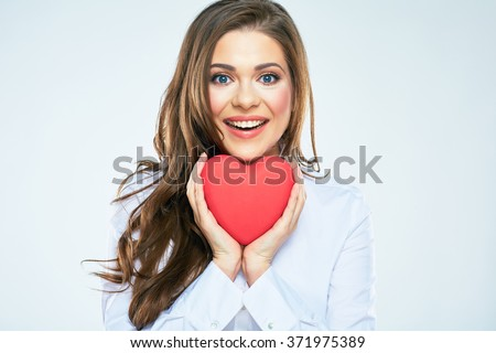 Happy woman hold red heart. Long curly hair. Beautiful female model posing on isolated white background. - stock photo