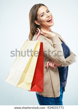 Happy woman hold shopping bags . White background studio isolated.