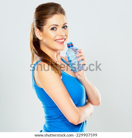 happy woman hold water bottle . portrait on studio isolated background . sport lifestyle . - stock photo