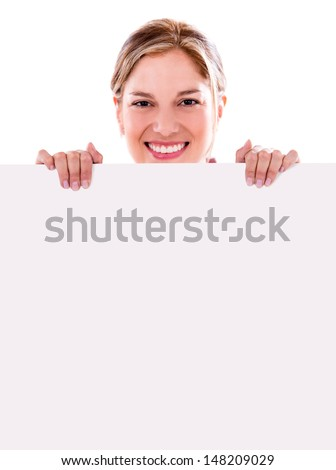 Happy woman holding a banner and smiling - isolated over white  - stock photo