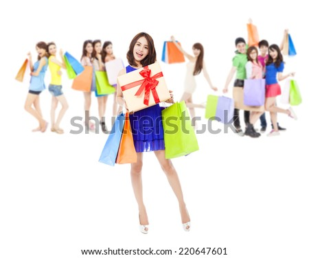happy woman holding a gift box and color bags with shopping friends.isolated on white background - stock photo