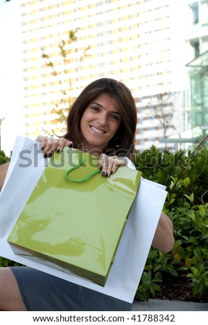 happy woman holding a lot of shopping bags