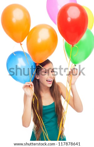 Happy woman holding balloons - stock photo