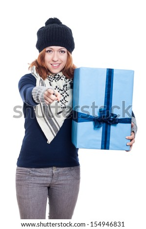 Happy woman holding big present and pointing at you, isolated on white background. - stock photo