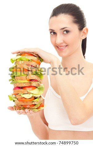 happy woman holding big sandwich, isolated on white - stock photo