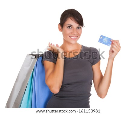 Happy Woman Holding Credit Card And Shopping Bag Over White Background