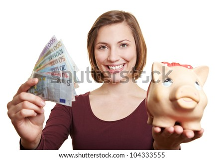 Happy woman holding Euro money bill fan and piggy bank - stock photo