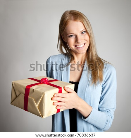 Happy woman holding gift box - stock photo
