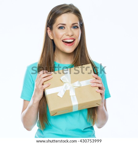 Happy woman holding gift box. Smiling girl with long hair.