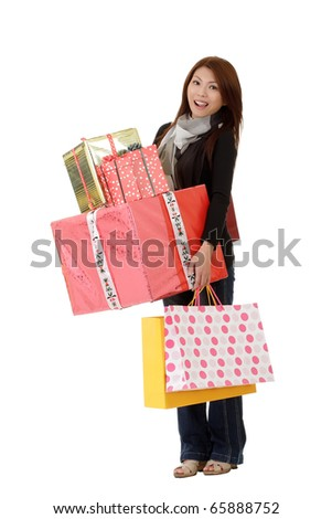Happy woman holding gifts and bags isolated over white.