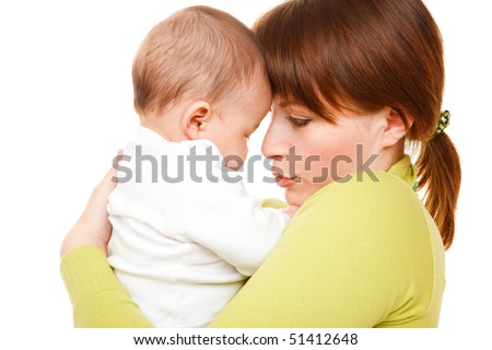 Happy woman holding her baby daughter in hands