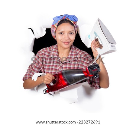 happy woman holding iron and vacuum cleaner - stock photo