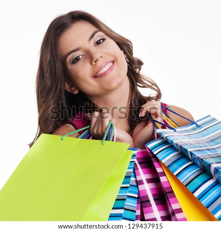 Happy woman holding multicolored shopping bags