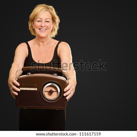 Happy Woman Holding Radio Isolated On Black Background - stock photo
