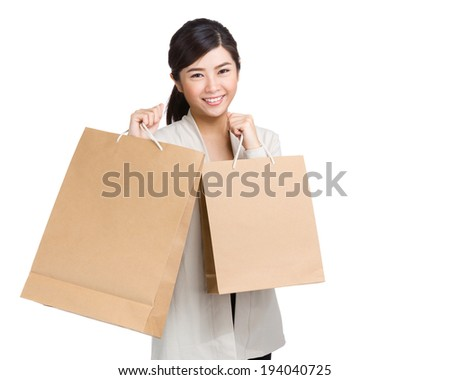 Happy woman holding shopping bag - stock photo