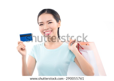 Happy woman holding shopping bags and smiling