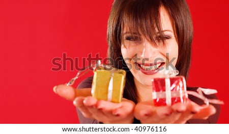 Happy woman holding two little gifts on her hands