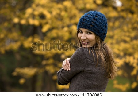 Happy woman in a beautiful autumn day - stock photo