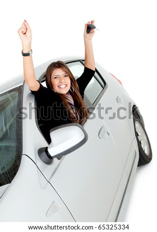 Happy woman in a car with arms up - isolated - stock photo