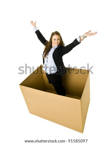 Happy Woman in a cardboard box isolated on white background - stock photo
