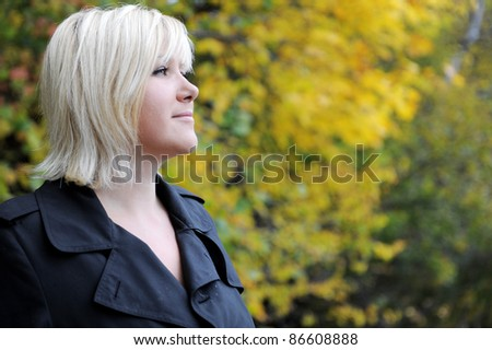 Happy woman in autumn - stock photo