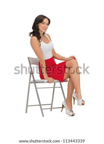 happy woman in blank white t-shirt on a chair - stock photo