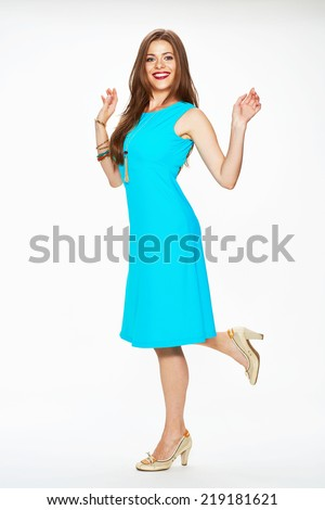 happy woman in blue dress posing against white background . isolated - stock photo
