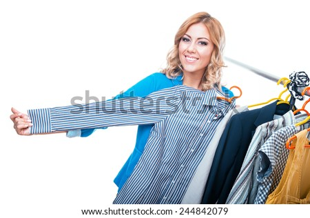 Happy woman in boutigue with shopping bags choosing shirt, isolated on white - stock photo