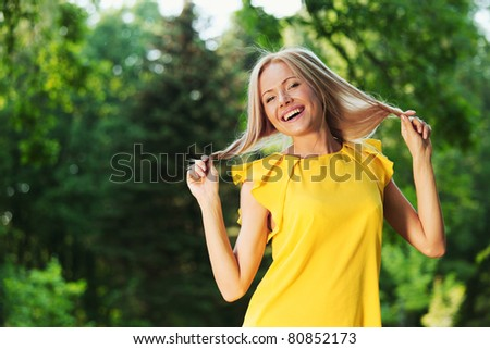 happy woman in forest - stock photo