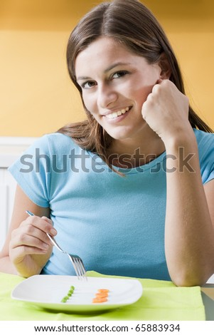 Happy Woman in front of her small diet meal