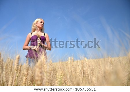 Happy woman in golden wheat - stock photo