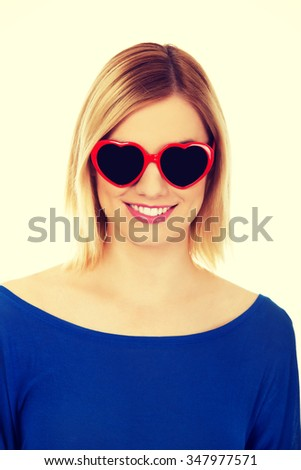 Happy woman in heart shaped sunglasses.