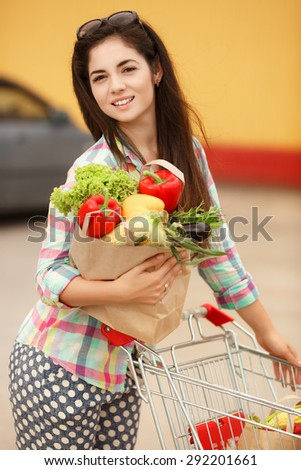 Happy woman in market, girl with vegetables at grocery shop, shopping young female with purchase, smiling woman with organic food at supermarket, instagam style filters, series - stock photo