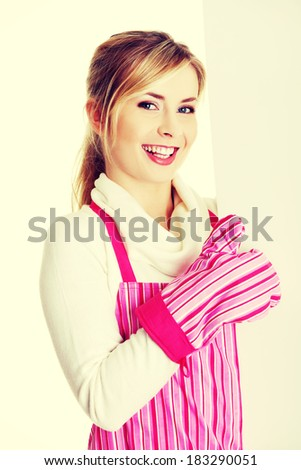 Happy woman in pink appron holding sign billboard and gesturing OK.  - stock photo