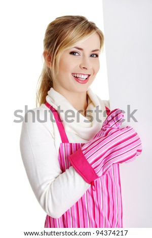 Happy woman in pink apron holding sign billboard and gesturing OK. Caucasian woman isolated on white background. - stock photo
