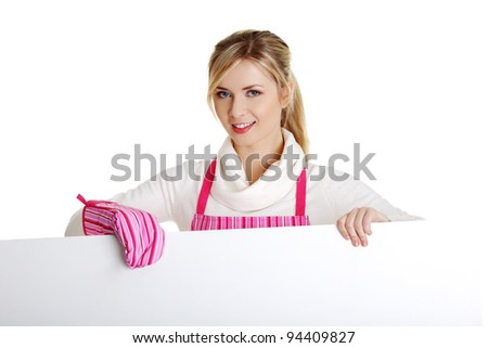 Happy woman in pink apron holding sign billboard. Caucasian woman isolated on white background. - stock photo