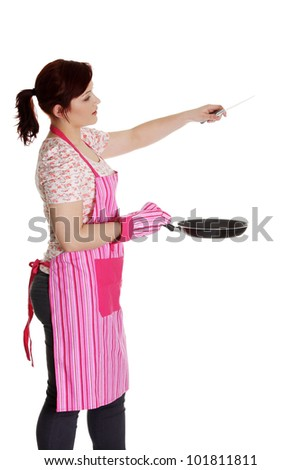 Happy woman in pink kitchen apron. Isolated on white background - stock photo
