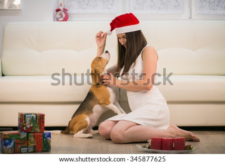 happy woman in santa hat with her dog