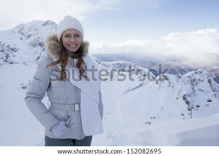 happy woman in snow mountain - stock photo