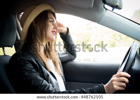 happy woman in summer hat driving car outdoors