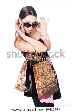 Happy woman in sunglasses on shopping - stock photo