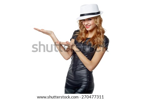 Happy woman in white straw hat,  showing holding on the palm blank copy space over white background - stock photo