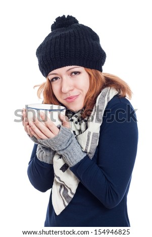 Happy woman in winter hat enjoying hot drink, isolated on white background.