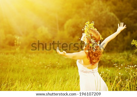 happy woman in wreath outdoors summer enjoying life opening hands  - stock photo