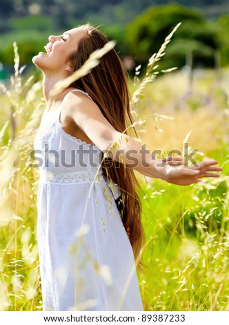 happy woman is at peace in the sunlight, carefree summer concept